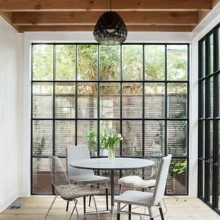 Dining room - farmhouse light wood floor and beige floor dining room idea in Austin with white walls