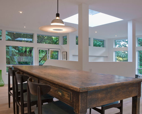 Example Of A Trendy Medium Tone Wood Floor Dining Room Design In Vancouver With White Walls