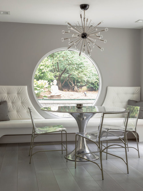 Inspiration For A Contemporary Gray Floor Dining Room Remodel In New York  With Gray Walls