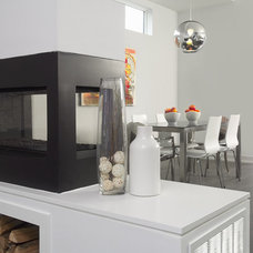 Modern Dining Room by Arnal Photography