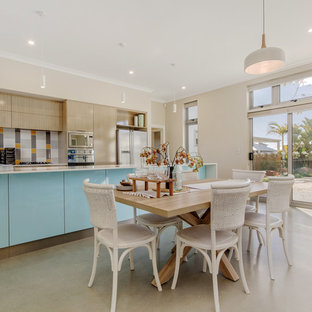 This is an example of a beach style dining room in Perth.