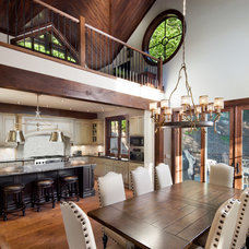 Rustic Dining Room by Progest Construction