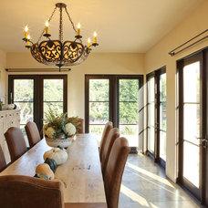 Mediterranean Dining Room by Allen Construction
