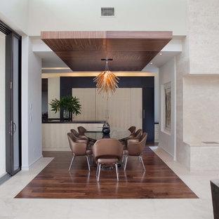 Свежая идея для дизайна: столовая в стиле модернизм с белыми стенами - отличное фото интерьера