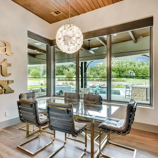Example of a tuscan dining room design in Austin