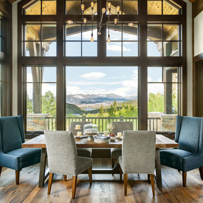 Inspiration for a rustic medium tone wood floor dining room remodel in Denver with white walls and no fireplace
