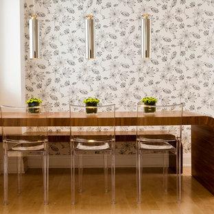 Minimalist light wood floor and beige floor dining room photo in Toronto with multicolored walls