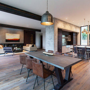Inspiration for a medium sized contemporary open plan dining room in Santa Barbara with grey walls and dark hardwood flooring.