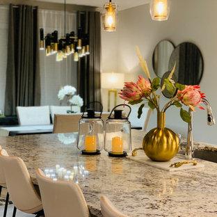 Immagine di una grande sala da pranzo aperta verso la cucina moderna con pareti beige, pavimento in marmo, camino ad angolo, cornice del camino piastrellata e pavimento bianco