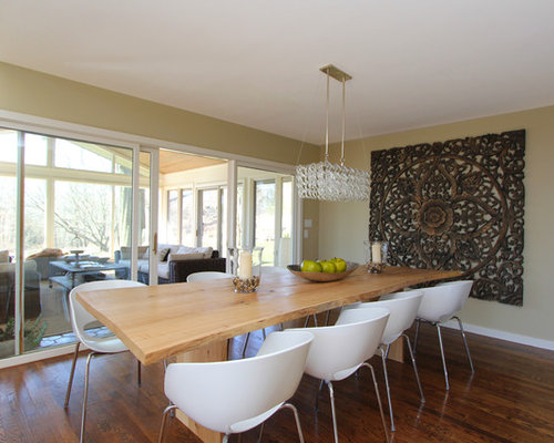 Contemporary Dark Wood Floor Dining Room Idea In New York With Beige Walls