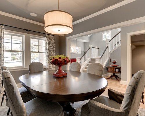 Example Of A Classic Dining Room Design In Minneapolis With Gray Walls