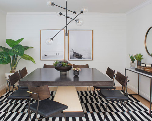 Example Of A Small Transitional Light Wood Floor And Multicolored Enclosed Dining Room Design In
