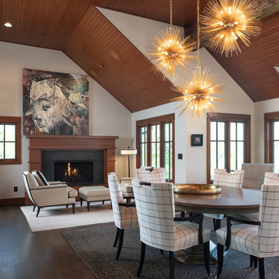 Mountain style dark wood floor and brown floor dining room photo in Kansas City with white walls and a standard fireplace