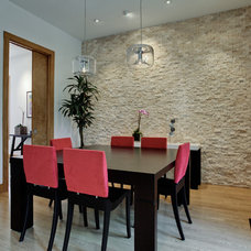 Modern Dining Room by DFW Improved