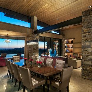 Idées déco pour une grand salle à manger ouverte sur le salon contemporaine avec un mur beige, un sol en marbre, une cheminée standard et un manteau de cheminée en béton.