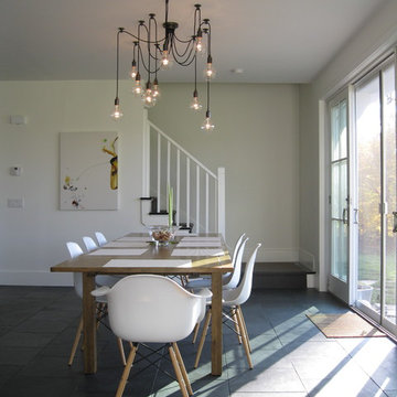 Modern dining area with Edison bulb chandelier