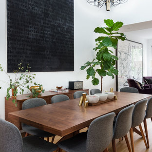 Kitchen/dining room combo - mid-sized contemporary light wood floor and brown floor kitchen/dining room combo idea in New York with white walls and no fireplace