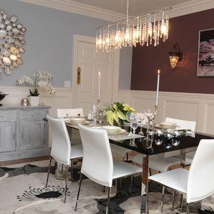 Esempio di una sala da pranzo moderna chiusa con pareti blu e pavimento in legno massello medio