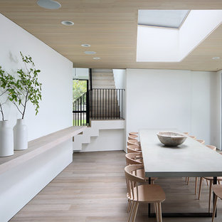 Example Of A Minimalist Light Wood Floor And Beige Dining Room Design In Milwaukee With