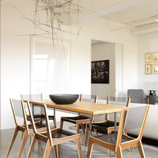 Industrial Dining Room by Croma Design Inc