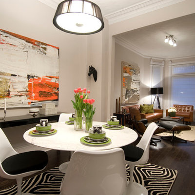 Minimalist dark wood floor dining room photo in Toronto with beige walls