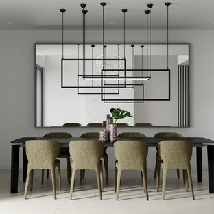 This is an example of a modern separate dining room in Brisbane with white walls and grey floor.