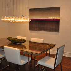Modern Dining Room by Klassmore Designs