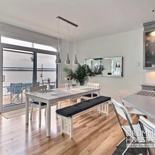 Trendy light wood floor kitchen/dining room combo photo in Montreal with white walls and no fireplace