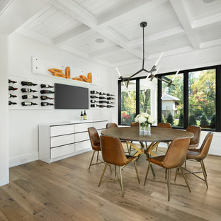 Dining room - huge farmhouse medium tone wood floor and brown floor dining room idea in Detroit with white walls