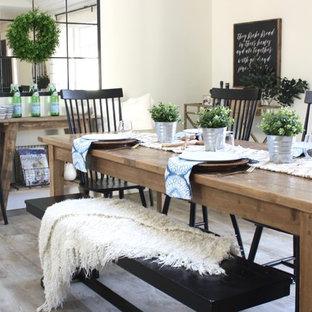 Bild på ett mellanstort lantligt kök med matplats, med vita väggar, vinylgolv och brunt golv