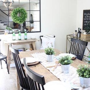 Idées déco pour une salle à manger ouverte sur la cuisine campagne de taille moyenne avec un mur blanc, un sol en vinyl, aucune cheminée et un sol marron.