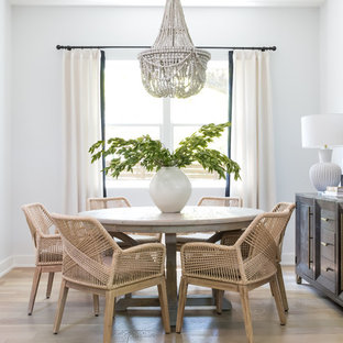 Example of a farmhouse light wood floor and beige floor dining room design in Austin with white walls and no fireplace