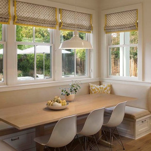 Example of a cottage light wood floor kitchen/dining room combo design in San Francisco with white walls