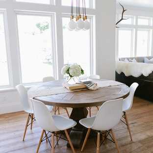 Example of a farmhouse medium tone wood floor great room design in Salt Lake City with white walls