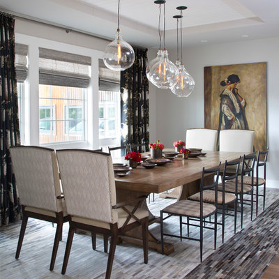 Inspiration for a transitional dark wood floor and brown floor enclosed dining room remodel in Denver with gray walls