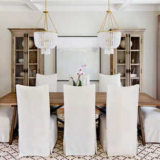 Example of a country medium tone wood floor and brown floor dining room design in Baltimore with beige walls