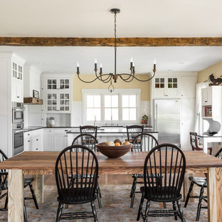 Inspiration for a large farmhouse medium tone wood floor kitchen/dining room combo remodel in Indianapolis with beige walls