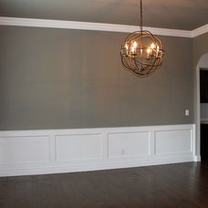 Mediterranean Dining Room by Homes of Distinction, Inc.