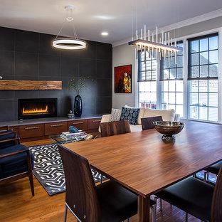 Foto de comedor contemporáneo, de tamaño medio, con paredes grises, suelo de madera en tonos medios, marco de chimenea de baldosas y/o azulejos y chimenea lineal