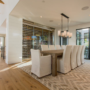 Country medium tone wood floor and brown floor dining room photo in Seattle with white walls