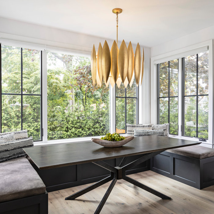 When presented with the overall layout of the kitchen, this dining space called out for more interest than just your standard table. We chose to make a statement with a custom three-sided seated banqu