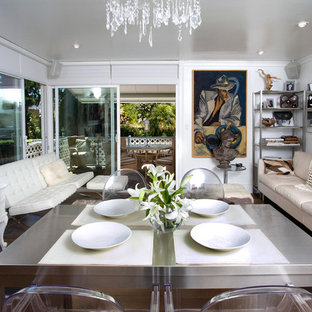 Inspiration for a beach style dark wood floor dining room remodel in Orange County with white walls