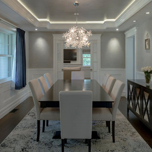 Medium sized modern enclosed dining room in Boston with grey walls, dark hardwood flooring, no fireplace and brown floors.