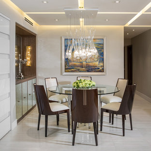 Inspiration for a mid-sized contemporary marble floor dining room remodel in Miami with beige walls and no fireplace