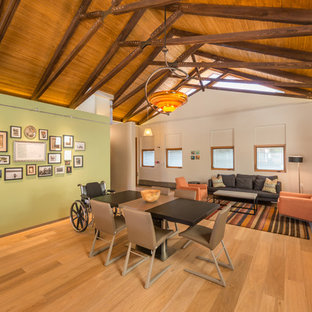 Example of a trendy light wood floor great room design in San Diego with green walls