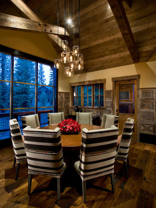 Mountain Style Dining Room Photo In Phoenix With Beige Walls And Dark Wood Floors