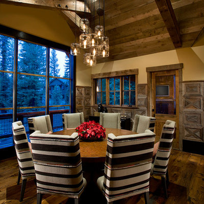 Large mountain style dark wood floor and brown floor dining room photo in Sacramento with beige walls