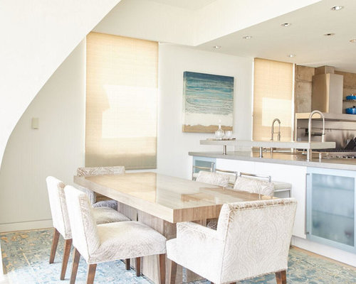 Inspiration For A Beach Style Kitchen Dining Combo Remodel In Orange County With White Walls