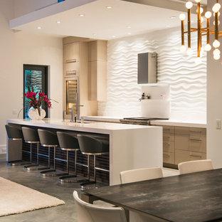 Immagine di una sala da pranzo aperta verso il soggiorno design di medie dimensioni con pareti bianche, nessun camino e pavimento in cemento