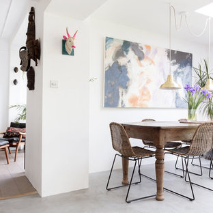 Photo of a large bohemian open plan dining room in Edinburgh with white walls, concrete flooring and grey floors.
